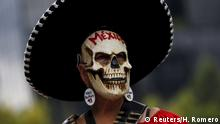 A demonstrator wearing a skull mask takes part in a protest to mark the eleven-month anniversary of their disappearance in Mexico City, Mexico August 26, 2015. The students' disappearance on the night of September 26, 2014 in the southwestern city of Iguala triggered massive protests in Mexico and calls for justice. Officials say they were abducted by corrupt police officers, who handed them over to a local drug gang. The words the earring read: We are missing 43. REUTERS/Henry Romero
