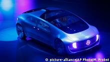 14.09.2015 **** An autonomous driving vehicle appears on stage during an event of the Daimler group on the eve of the Frankfurt Auto Show IAA in Frankfurt, Germany, Monday, Sept. 14, 2015. (AP Photo/Michael Probst)