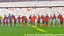 Bayern Munich Football Team with refugee kids