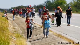 Refugees walk on a road near Edirne, Turkey (Reuters/O. Orsal)