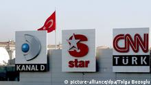 Three Turkish channel logos of Dogan Holding Company seen front of the Dogan TV central building in Istanbul, Turkey on Thursday 16 November 2006. Germany publisher Axel Springer bought into Turkey's growing broadcasting market on Thursday, signing a deal to buy 25 percent of Dogan TV for 375 million euros ($480 million). EPA/TOLGA BOZOGLU +++(c) dpa - Report+++