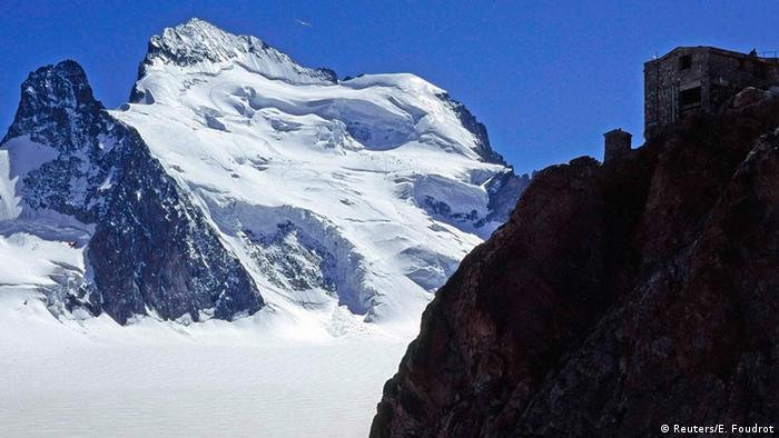An archive picture shows the Dome and the Barre des Ecrins mountains in the French Alps