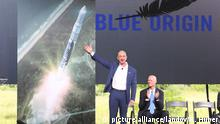 Image #: 39425156 Amazon.com CEO and Blue Origin founder Jeff Bezos, left, debuts a launch vehicle on Tuesday, Sept. 15, 2015, as Florida Gov. Rick Scott applauds during a press conference at launch complex 36 at Cape Canaveral Air Force Station. Bezos said his company would bring over 300 new jobs to Florida's space coast. (Red Huber/Orlando Sentinel/TNS) Orlando Sentinel/ TNS /LANDOV