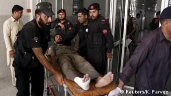 Emergency workers wheel an injured man to a hospital after an attack on an air force base in Peshawar, Pakistan, September 18, 2015 (Photo: REUTERS/Khuram Parvez)
