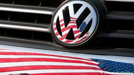 The US flag reflecting in a VW emblem.