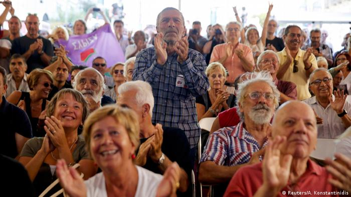 Supporters of leftist Syriza party at the party's main election kiosk applaud after the announcement of the first exit polls in Athens, Greece, on September 20, 2015. (Reuters/A. Konstantinidis)