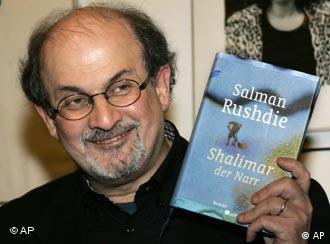 Salman Rushdie poses with his 2005 novel Shalimar the Clown