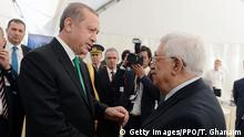 MOSCOW, RUSSIA - SEPTEMBER 23: In this handout image supplied by the Palestinian President's Office (PPO), Palestian President Mahmoud Abbas (R) is greeted by Turkish President Tayyip Erdogan during an opening ceremony for the newly restored Moscow Cathedral Mosque on September 23, 2015 in Moscow, Russia. (Photo by Thaer Ghanaim/PPO via Getty Images)