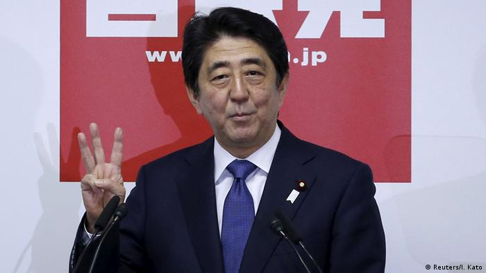 Japan's Prime Minister Shinzo Abe, who is also the ruling Liberal Democratic Party leader, gestures during a news conference.