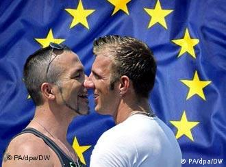Two men in front of the European Union flag