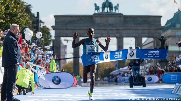 Eliud Kipchoge winning the Berlin Marathon - pictured in front of the Brandenburg gate