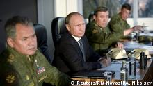 September 19, 2015. Russian President Vladimir Putin (C) with Defence Minister Sergei Shoigu (L) and armed forces Chief of Staff Valery Gerasimov observe troops in action during a training exercise at the Donguz testing range in Orenburg region, Russia, September 19, 2015. REUTERS/Alexei Nikolsky/RIA Novosti/Pool ATTENTION EDITORS - THIS IMAGE HAS BEEN SUPPLIED BY A THIRD PARTY. IT IS DISTRIBUTED, EXACTLY AS RECEIVED BY REUTERS, AS A SERVICE TO CLIENTS.