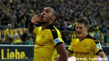 Borussia Dortmund's Pierre-Emerick Aubameyang celebrates with Matthias Ginter (R) after scoring a second goal against Darmstadt 98 during the Bundesliga first division soccer match in Dortmund, Germany September 27, 2015. REUTERS/Ina Fassbender DFL RULES TO LIMIT THE ONLINE USAGE DURING MATCH TIME TO 15 PICTURES PER GAME. IMAGE SEQUENCES TO SIMULATE VIDEO IS NOT ALLOWED AT ANY TIME. FOR FURTHER QUERIES PLEASE CONTACT DFL DIRECTLY AT + 49 69 650050.