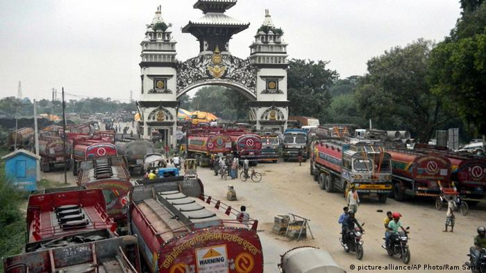 Goods trucks are stranded on the India-Nepal border.