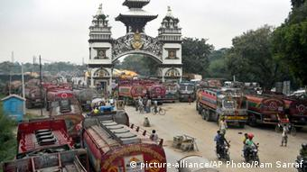 Nepalese oil tankers and commercial trucks stand stranded near a gate that marks the Nepalese border with India, in Birgunj, Nepal, Thursday, Sept. 24, 2015(AP Photo/Ram Sarraf)