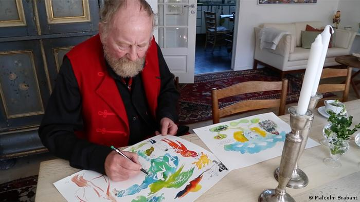 Kurt Westergaard paints in his Aarhus home