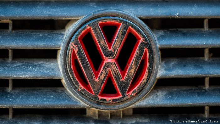 A worn VW logo