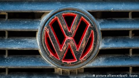 A rusted VW logo
