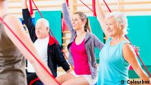 Senior people at fitness course in gym exercising with stretch band. #12620932 Copyright: Colourbox
