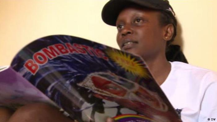Kasha Nabagesera holds a copy of the LGBT magazine Bombastic. Copyright: DW