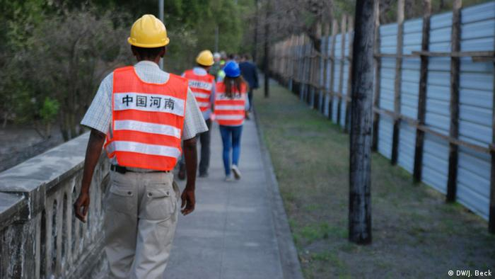 Mozambicans on their way to work at a Chinese construction site