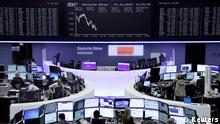 01.10.2015+++ Traders work at their screens in front of the German share price index, DAX board, at the stock exchange in Frankfurt, Germany, October 1, 2015. REUTERS/Staff/remote