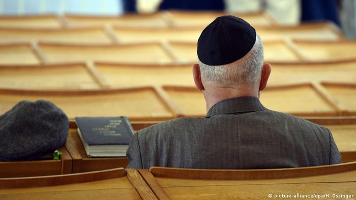 Man wearing a kippa in a synagogue