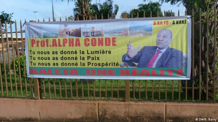 A poster praising resident Conde for bringing light, peace and prosperity to Guinea