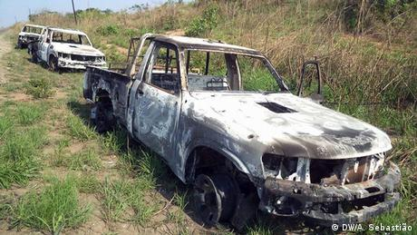 Three burned-out cars in a field in Mozambique
