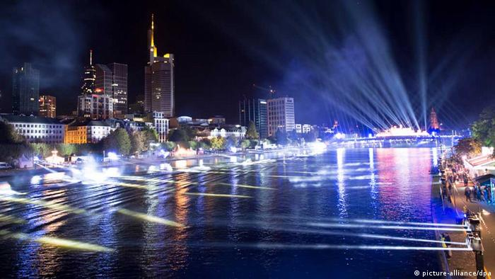 A light show over the river Main in Frankfurt