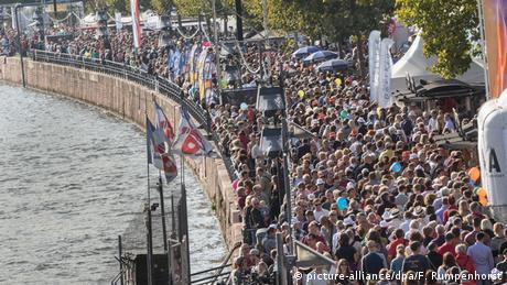 Thousands of people line the banks of the river Main in Frankfurt