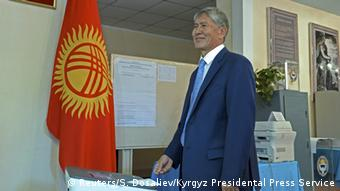President Almazbek Atambayev casts a ballot during a parliamentary election at a polling station in Bishkek.
