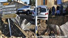4. Okt People look at the rubble in the aftermath of violent storms and floods in Biot, southeastern France, on October 4, 2015. Violent floods along the French riviera killed 13 people by early Sunday, emergency responders and local officials said, including three who drowned in a retirement home inundated when a river broke its banks.AFP PHOTO / JEAN CHRISTOPHE MAGNENET (Photo credit should read JEAN-CHRISTOPHE MAGNENET/AFP/Getty Images)