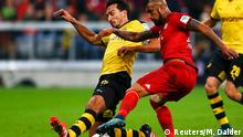Bayern Munich's Arturo Vidal fights for the ball with Borussia Dortmund's Mats Hummels (L) during their German first division Bundesliga soccer match in Munich, Germany, October 4, 2015. REUTERS/Michael Dalder DFL RULES TO LIMIT THE ONLINE USAGE DURING MATCH TIME TO 15 PICTURES PER GAME. IMAGE SEQUENCES TO SIMULATE VIDEO IS NOT ALLOWED AT ANY TIME. FOR FURTHER QUERIES PLEASE CONTACT DFL DIRECTLY AT + 49 69 650050.