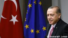 5.10.2015 *** Turkey's President Tayyip Erdogan waits for the start of a meeting with European Council President Donald Tusk (unseen) at the EU Council in Brussels, Belgium October 5, 2015. Erdogan appeared to mock European Union overtures for help with its migration crisis as he arrived for a long-awaited state visit to Brussels and a string of meetings with EU leaders set to start on Monday. REUTERS/Francois Lenoir