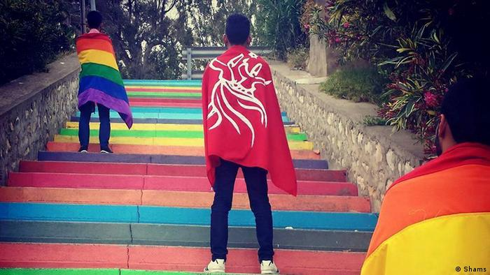 Homosexual activists with rights group Shams participating in a campaign in Tunisia with the group flag and the rainbow flag