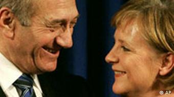 Israeli Prime Minister Ehud Olmert, left, looks at German Chancellor Angela Merkel,