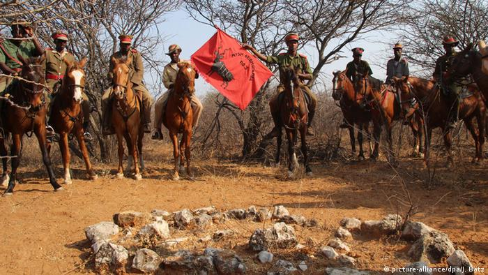 Herero on horseback commemorate the anniversary of the German genocide