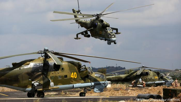 Russian MI-24 combat helicopters landing