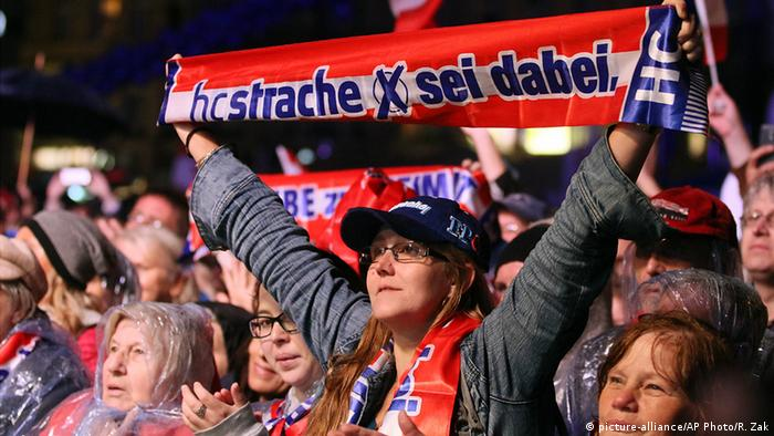 Young FPÖ supporter holding up a sign during a rally in Vienna. (Photo: AP Photo/Ronald Zak)