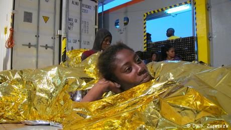 A woman rests on the Argos rescue vessel