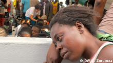 """Description of photo: A woman waits for medical attention at the Dignity 1 Title: """"The nightmare is over"""" Series Title in case there are several pictures about one topic: Navigating a sea of refugees Tags: Refugees, Dignity, MSF, rafts, Migrant boats, Libya Name of the photographer/or source : Karlos Zurutuza When was the pic taken? (October 2015) Where was the pic taken (Mediterranean sea) Description of the pic /occasion, situation when pic was taken, whom or what does the pic show? Many among the female refugees report sexual abuses at Libya´s infamous detention centres. Other than medical and psychological attention, the MSF crew also offers an AIDS test on board. """"Most of them are traumatised and those who dare to speak tell gruesome stories,"""" MSF member on board Laura Pasquero told DW."""