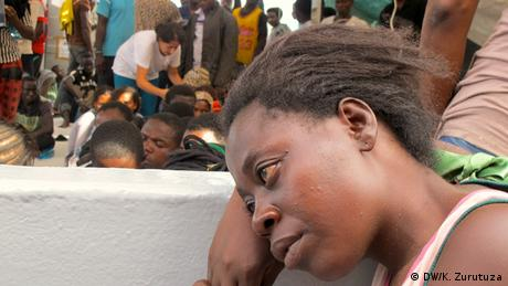 A woman waits for medical attention on the Dignity 1