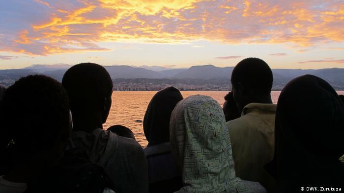 A group of sub-Saharan refugees overlook Reggio Calabria, southern Italy, from the Argos rescue vessel deck