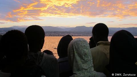 A group of sub-Saharan refugees overlook Reggio Calabria, southern Italy, from the