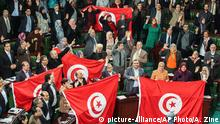 26.1.2014 *** FILE - In this Sunday, Jan. 26, 2014 file photo, members of the Tunisian National Constituent Assembly celebrate the adoption of the new constitution in Tunis, Tunisia. A Tunisian democracy group won the Nobel Peace Prize on Friday for its contributions to the first and most successful Arab Spring movement. The Norwegian Nobel Committee cited the Tunisian National Dialogue Quartet for its decisive contribution to the building of a pluralistic democracy in the North African country following its 2011 revolution. (AP Photo/Aimen Zine, File)