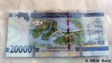 20.000 Francs-Scheins aus Guinea einpflegen. Es zeigt den Staudamm von Kaleta, ein Vorzeigeprojekt der Regierung Alpha Condé. Fotograf ist Bob Barry aus unserer Redaktion