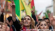 9.9.2015 *** A woman holding a protest march during the attacks on the Kurds in Turkey on 09/09/2015 in Berlin , Germany, the Victory sign into the air . Several hundred people demonstrated in Kreuzberg against attacks on Kurds and Kurdish institutions in Turkey in recent days. (Photo by Markus Heine/NurPhoto)