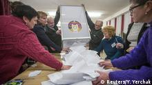 Members of a local electoral commission empty a ballot box at a polling station in Minsk, Belarus, October 11, 2015. Exit polls in Belarus showed President Alexander Lukashenko winning a fifth term by a landslide on Sunday in elections that could see an easing of relations with the West and raise questions about his ties to Vladimir Putin's Russia. REUTERS/Yauhen Yerchak