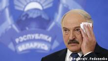 October 11, 2015 Belarus' President Alexander Lukashenko wipes his face at a news conference during a presidential election in Minsk, Belarus, October 11, 2015. Belarussians head to the polls on Sunday to cast their vote in presidential elections all but certain to re-elect authoritarian incumbent Alexander Lukashenko for a fifth term. REUTERS/Vasily Fedosenko